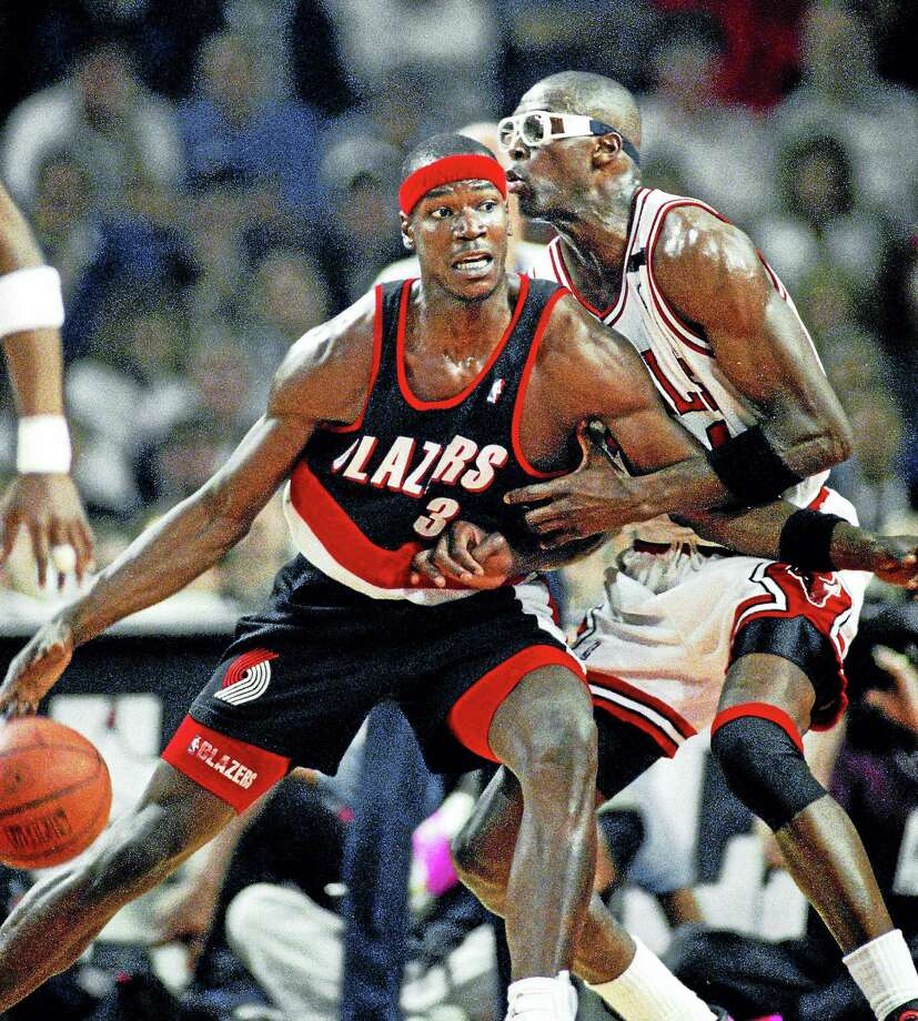 In this June 4, 1992 photo, Portland Trail Blazers' Cliff Robinson drives on Chicago Bulls' Horace Grant during Game 1 of the NBA Finals in Chicago. Photo: AP Photo — John Swart, File  / AP