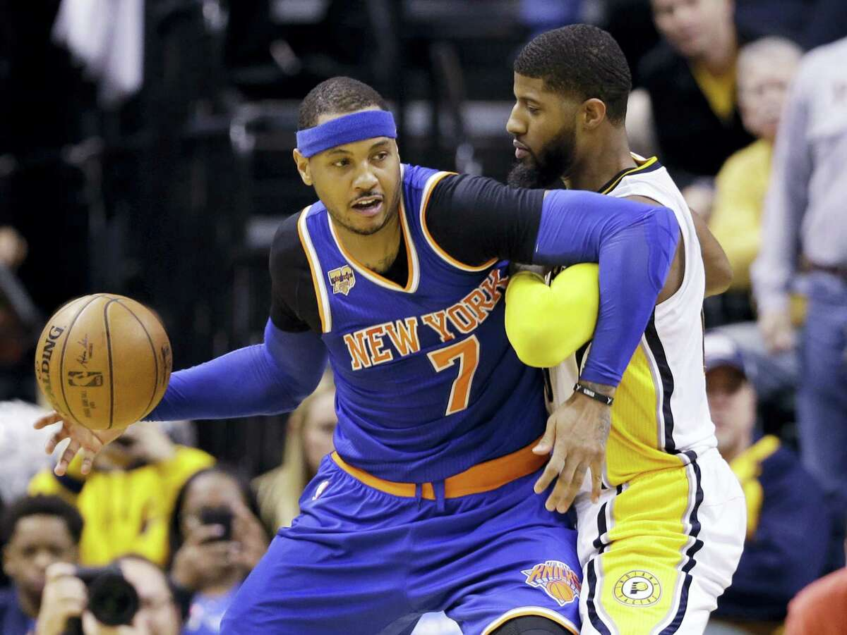 New York Knicks forward Carmelo Anthony (7) works against Indiana Pacers forward Paul George (13) during the second half of an NBA basketball game in Indianapolis on Jan. 23, 2017. The Knicks defeated the Pacers 109-103.