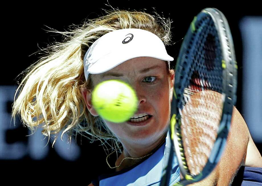 United States' Coco Vandeweghe makes a backhand return to Spain's Garbine Muguruza during their quarterfinal at the Australian Open tennis championships in Melbourne, Australia on Jan. 24, 2017. Photo: AP Photo/Dita Alangkara  / Copyright 2017 The Associated Press. All rights reserved.