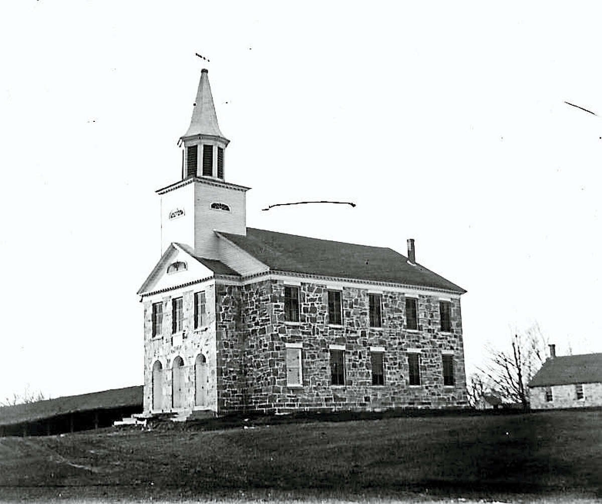 The Stone Church of the First Ecclesiastical Society of New Preston at 100 New Preston Hill Road. Photograph by Joseph West in 1899.
