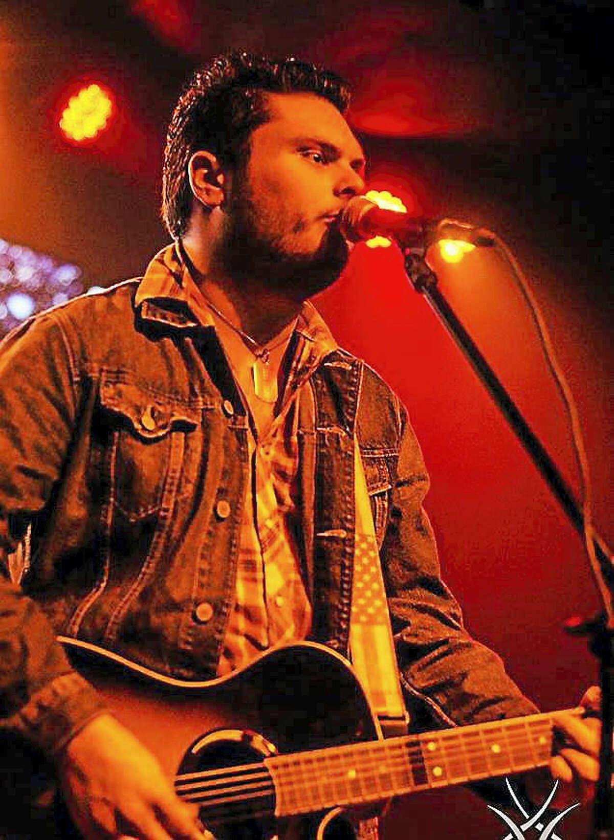 Contributed photo Torrington native Cody Wolfe, shown performing in 2016, recently signed with a record label. The singer is pursusing a country music career in Nashville, Tenn.