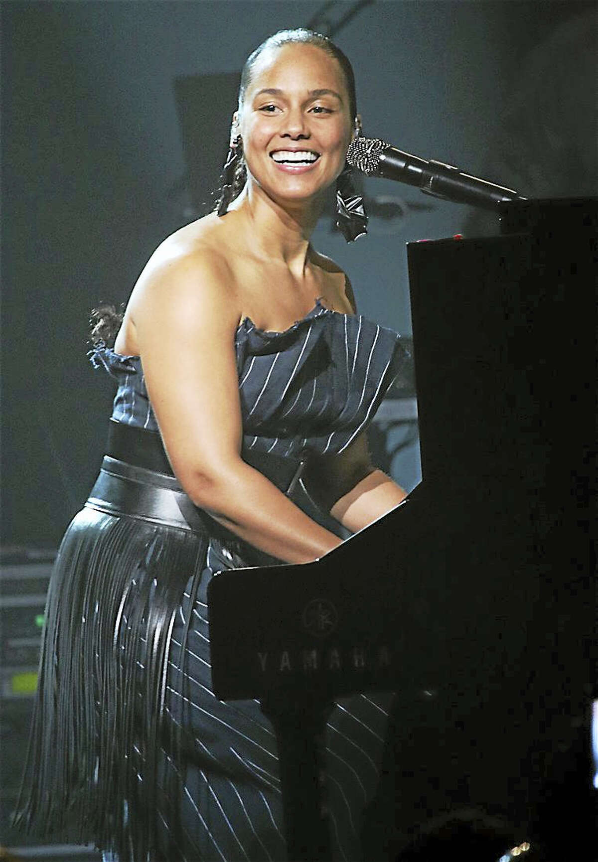 """Photo by John Atashian Singer, songwriter, pianist and actress, Alicia Keys, is shown smiling out to the packed house of fans during her concert appearance at the Foxwoods Resort Casino on Sunday night March 12, 2017. Alicia is currently on touring the US in support of her brand album """"Here"""". To learn more you can visit www.here.aliciakeys.com"""