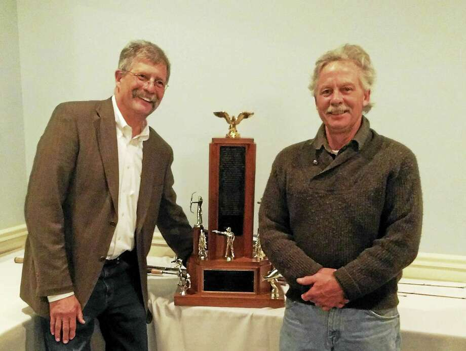 The Northwestern CT Sportsmen's Association held its 90th annual banquet on April 21st at the Crystal peak banquet facility in Winsted. Over 180 members and their guest attended the celebration. The annual gathering brought together members of the local sportsmen club that was established in 1927 to honor one of their own. The Peter Holms Trophy for Sportsman of the Year was awarded to Thomas Wolf. Mr. Wolf is the Trap co-Chairman and has been instrumental in promoting the sport of Trap shooting at the club's facility and put in many hours in constructing the new club house at the organization facility located in town of Colebrook. Mr. Wolf is a resident of Cornwall. This award is given out annually to a member of the club who best exemplifies a true Sportsman in promoting the outdoor sports and the welfare of the organization. The club located on Rt. 44 in Colebrook. Northwestern CT Sportsmen's Association President, Tom Andersen (left) presents The Peter Holms Trophy for Sportsman of the Year for 2016 to Thomas Wolf (right) of Cornwall. For more information on this event, you can also call me at (203) 983-0696 Jason Marshall N.W.C.S.A. P.O. Box 618 Winsted, CT 06098 Photo: CREDIT HERE