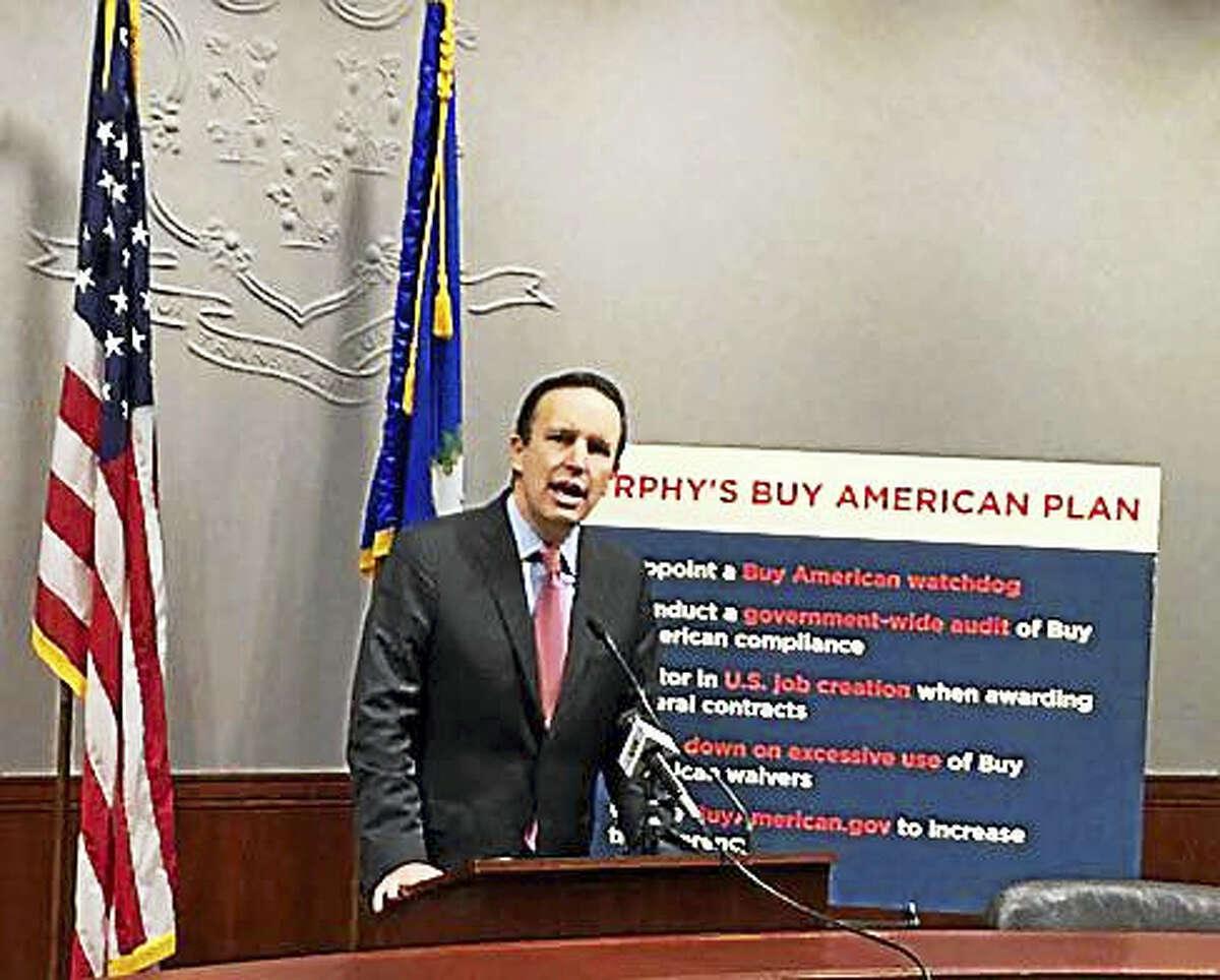 U.S. Chris Murphy speaks to reporters Monday in the Legislative Office Building in Hartford.