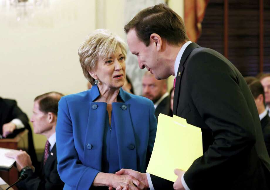 Small Business Administration Administrator-designate, former wrestling entertainment executive, Linda McMahon shakes hands with U.S. Sen. Chris Murphy, D-Conn., on Capitol Hill in Washington, Tuesday, Jan. 24, 2017, prior to her confirmation before the Senate Small Business and Entrepreneurship Committee. Photo: Alex Brandon — AP Photo / Copyright 2017 The Associated Press. All rights reserved.