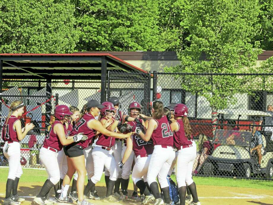The Red Raiders welcome Ali DuBois home after Dubois's home run vaulted them into the lead against Watertown Thursday. Photo: Photo By Peter Wallace