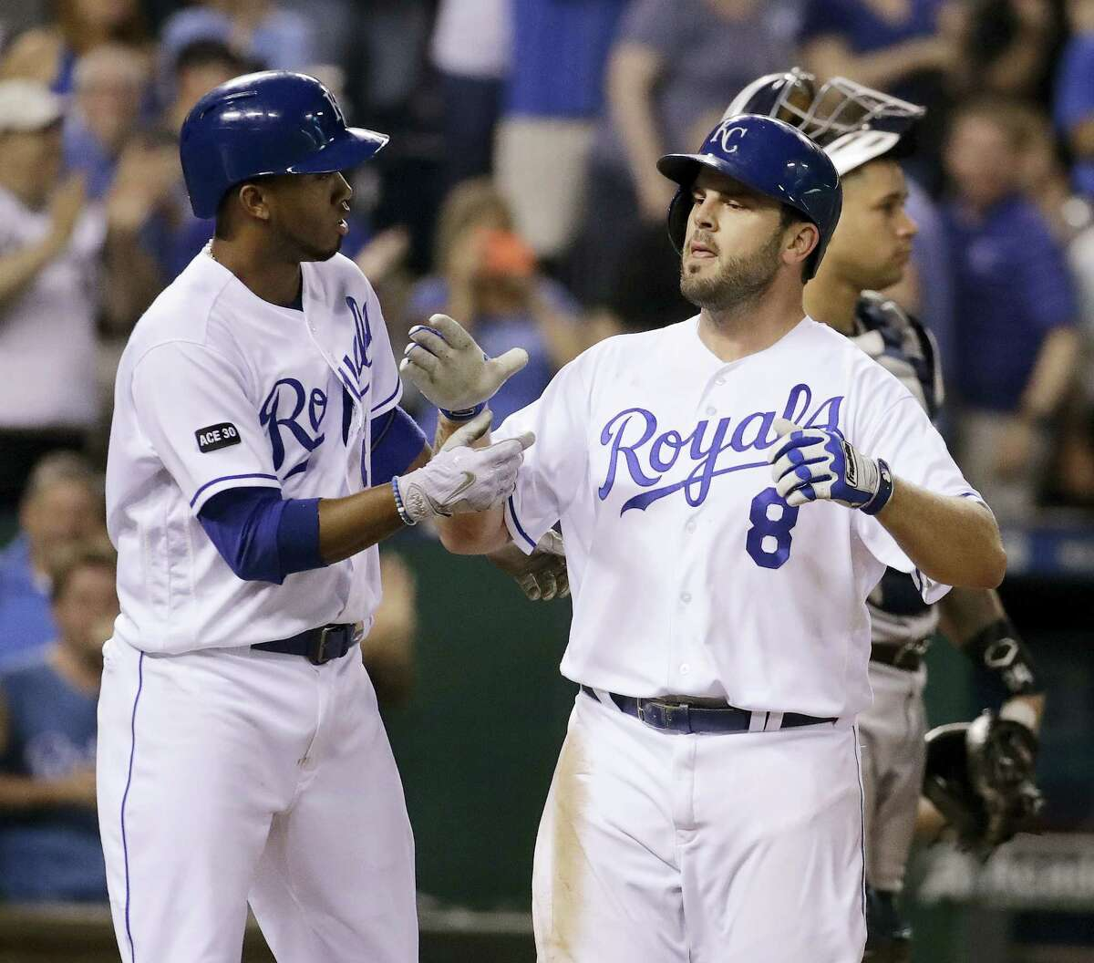 The Royals' Mike Moustakas (8) celebrates with Alcides Escobar after hitting a three-run home run in the fifth inning Thursday.