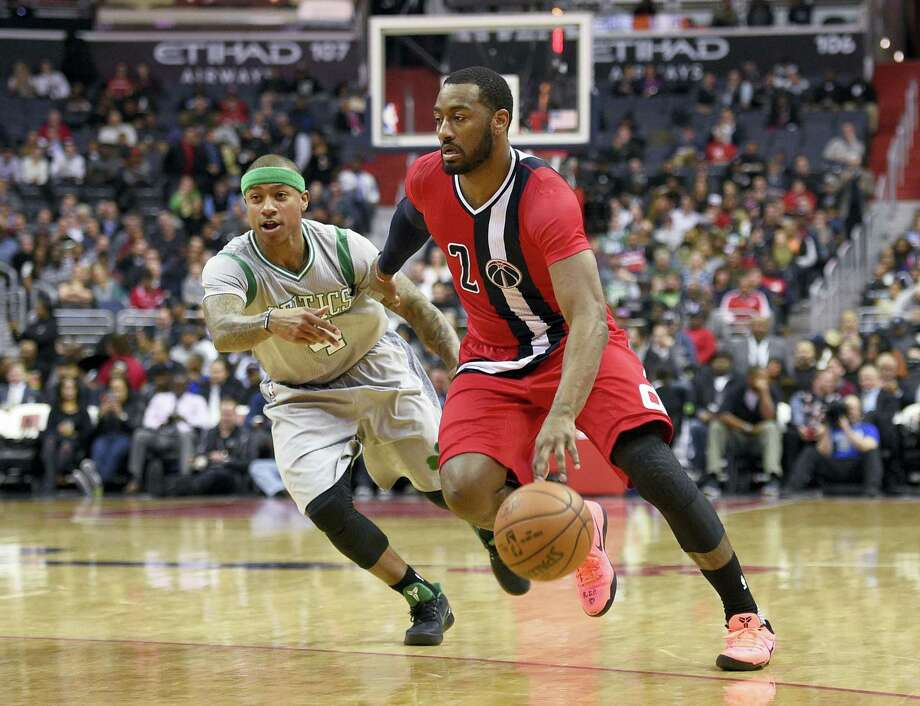 Washington Wizards guard John Wall (2) drives to the basket past Boston Celtics guard Isaiah Thomas (4) during the first half of an NBA basketball game, Tuesday, Jan. 24, 2017, in Washington. (AP Photo/Nick Wass) Photo: AP / FR67404 AP