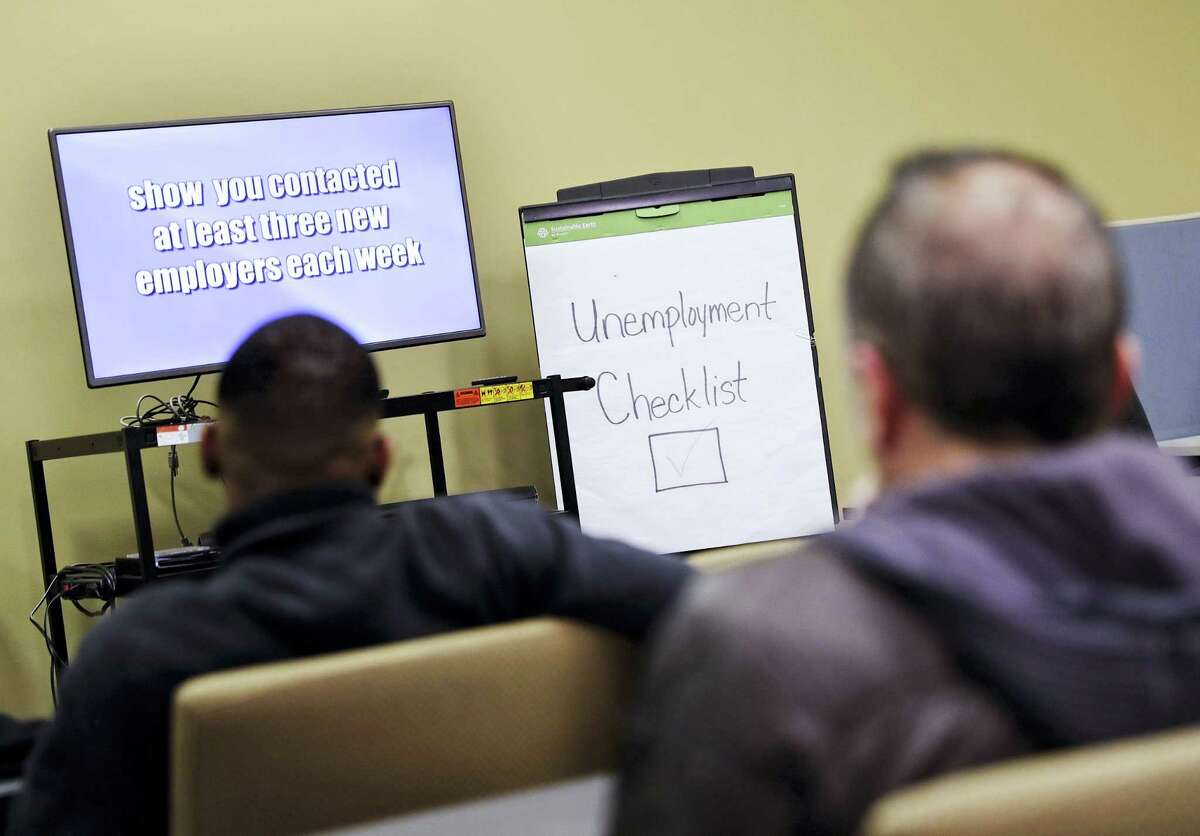In this Thursday, March 3, 2016, file photo, people sit through an employment orientation class at the Georgia Department of Labor office in Atlanta. On Thursday, May 18, 2017, the Labor Department reports on the number of people who applied for unemployment benefits a week earlier.