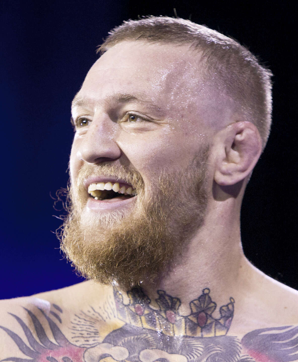 In this March 2, 2016 photo, UFC featherweight champion Conor McGregor smiles during open workouts at the MGM Grand in Las Vegas. McGregor has come to an agreement with UFC that has moved a proposed fight with Floyd Mayweather Jr. closer to reality.