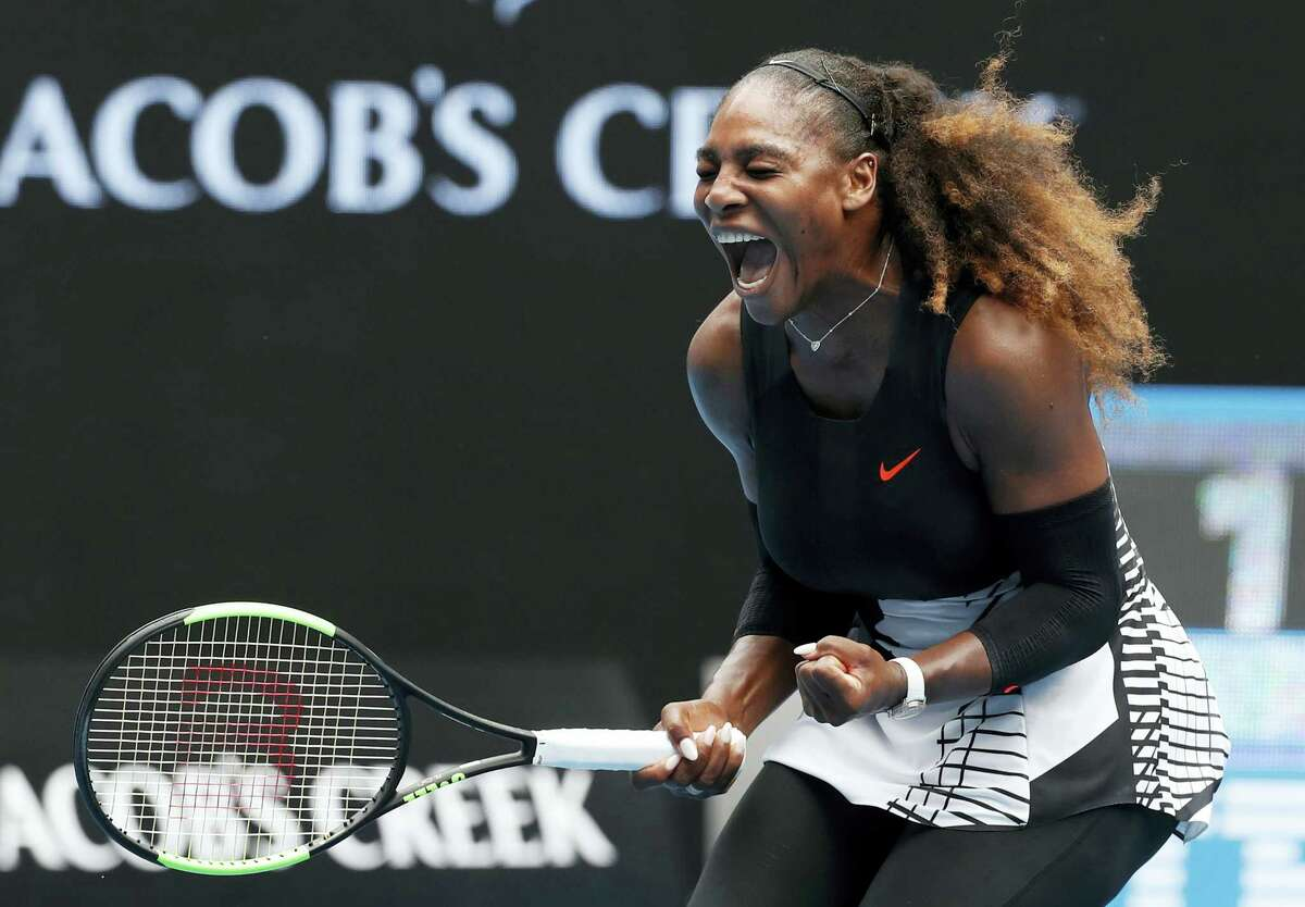 Serena Williams celebrates after winning the first set against Barbora Strycova during their fourth-round match at the Australian Open.