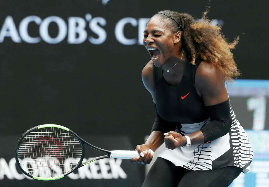 Serena Williams celebrates after winning the first set against Barbora Strycova during their fourth-round match at the Australian Open. Photo: Kin Cheung — The Associated Press  / Copyright 2017 The Associated Press. All rights reserved.