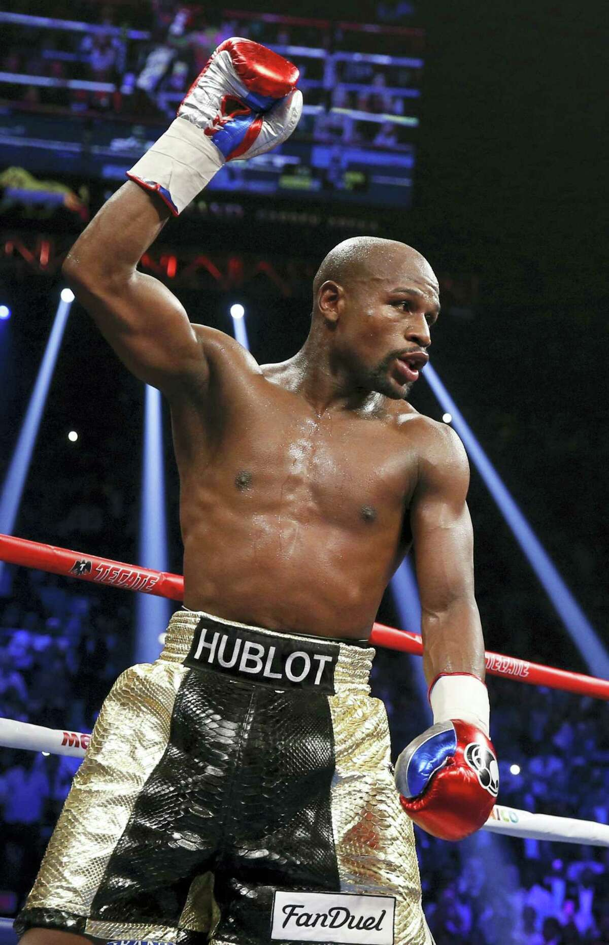 In this May 2, 2015 photo, Floyd Mayweather Jr. celebrates during his welterweight title fight against Manny Pacquiao, in Las Vegas. Conor McGregor has come to an agreement with UFC that has moved a proposed fight with Floyd Mayweather Jr. closer to reality.