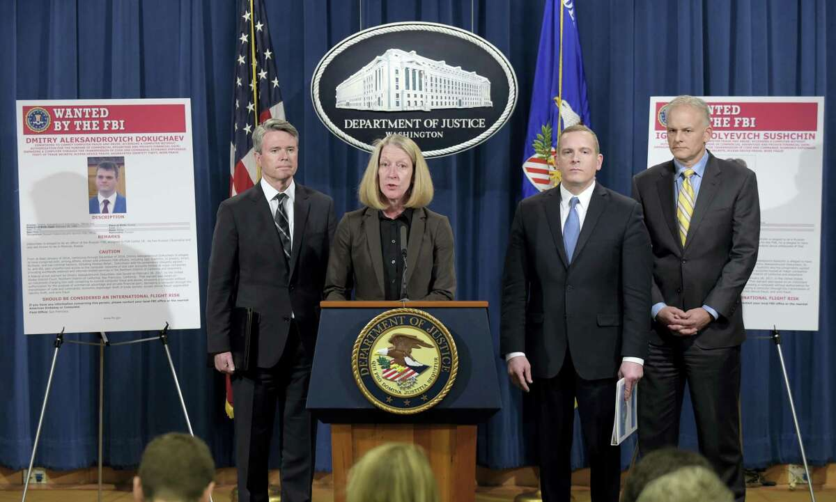 Acting Assistant Attorney General Mary McCord, second from left, speaks during a news conference at the Justice Department in Washington on March 15, 2017. The Justice Department announced charges against four defendants, including two officers of Russian security services, for a mega data breach at Yahoo. Accord is joined by from left, U.S. Attorney for the Northern District Brian Stretch, FBI Executive Director Paul Abbate, Office of International Affairs Director Vaughn Ary.