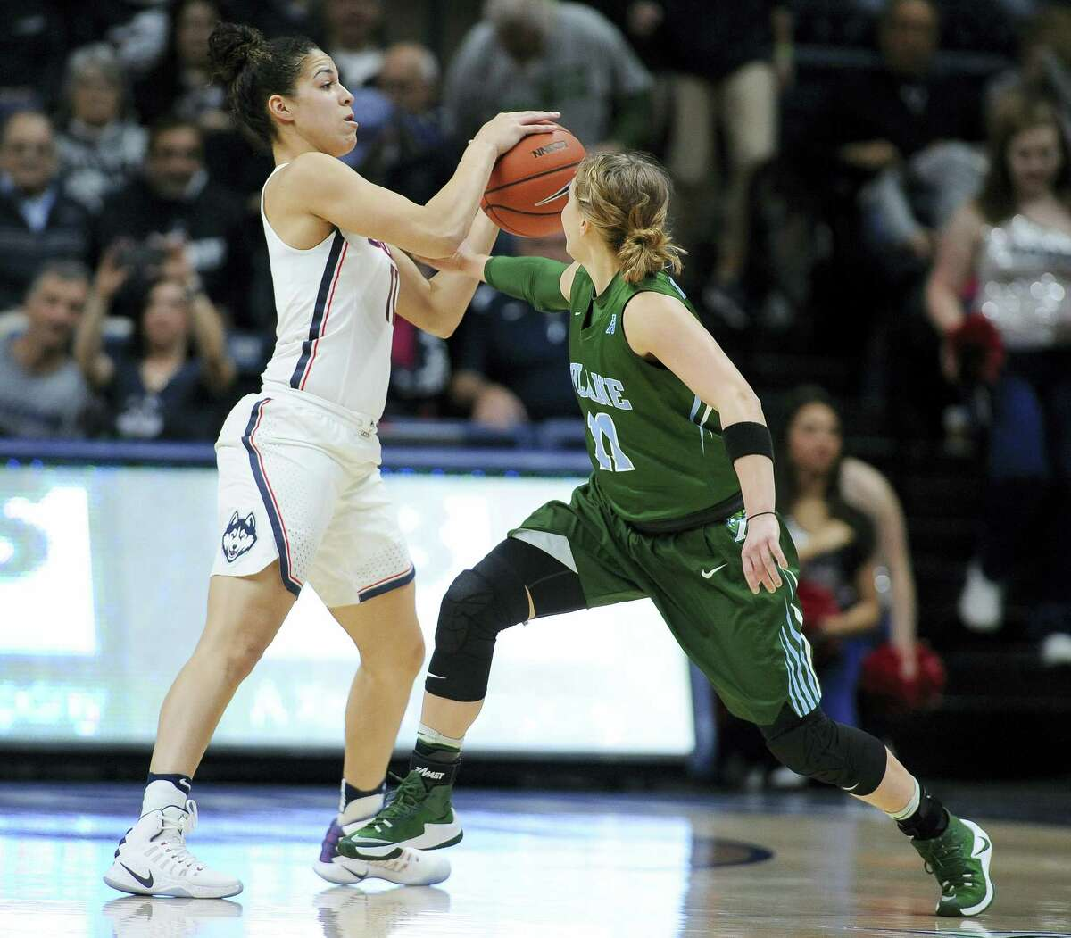 UConn's Kia Nurse, left, steals the ball from Tulane's Leslie Vorpahl during their game on Sunday.