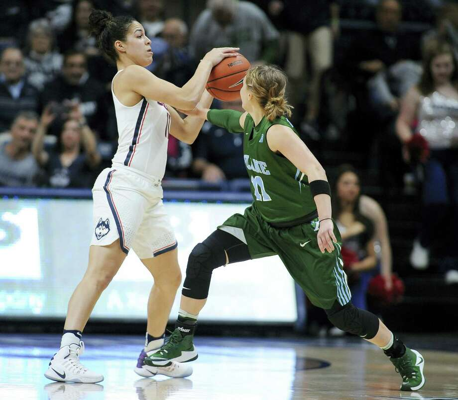 UConn's Kia Nurse, left, steals the ball from Tulane's Leslie Vorpahl during their game on Sunday. Photo: Jessica Hill — The Associated Press File Photo  / AP2017