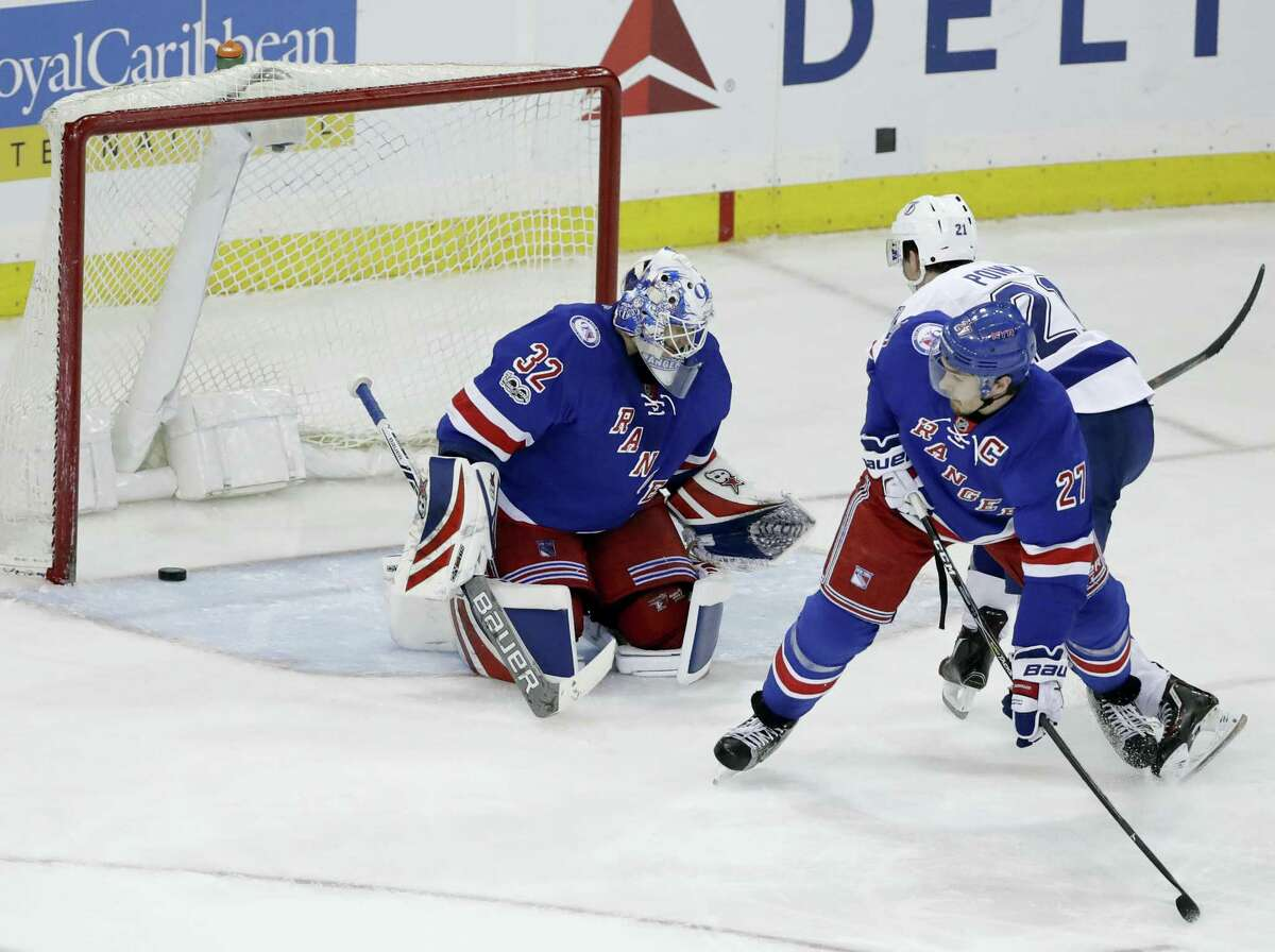 New York Rangers' Ryan McDonagh (27) watches as Tampa Bay Lightning's Brayden Point (21) shoots the puck past goalie Antti Raanta (32) during the third period of an NHL hockey game, Monday, March 13, 2017, in New York. The Lightning won 3-2.