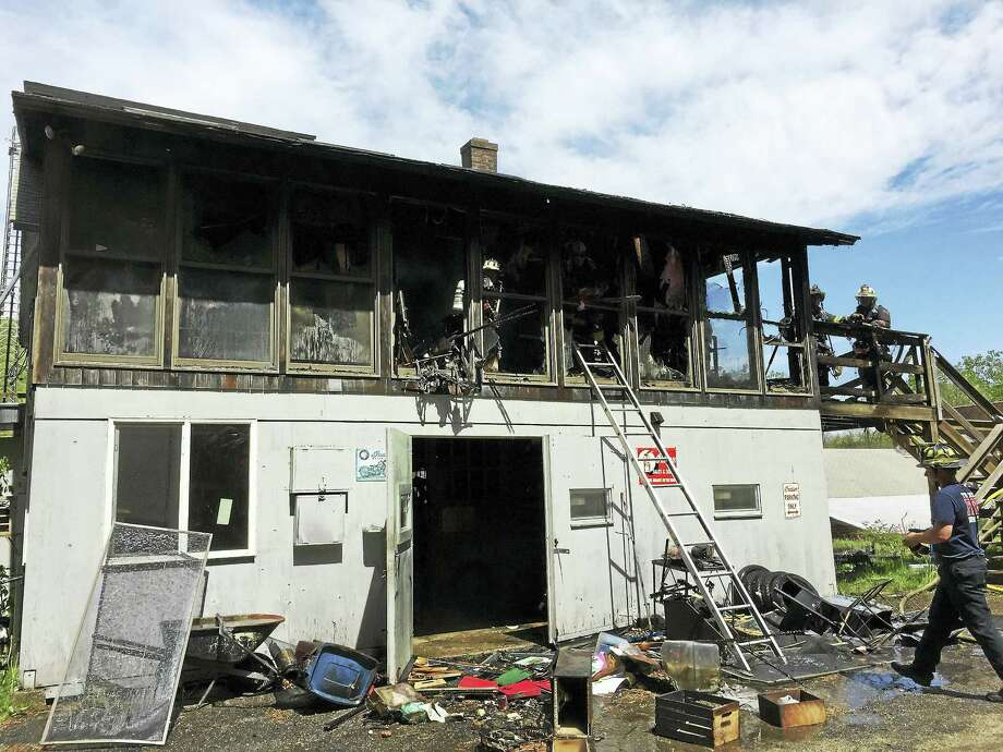 Torrington firefighters responded to a fire on Riverside Avenue early Thursday afternoon. No injuries were reported. Photo: Ben Lambert — The Register Citizen