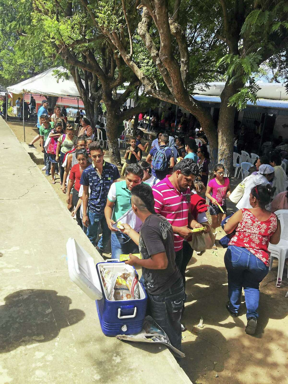 Contributed photos Residents from around the southern area of San Juan del Sur in Nicaragua wait in line to be examined by an eye doctor.