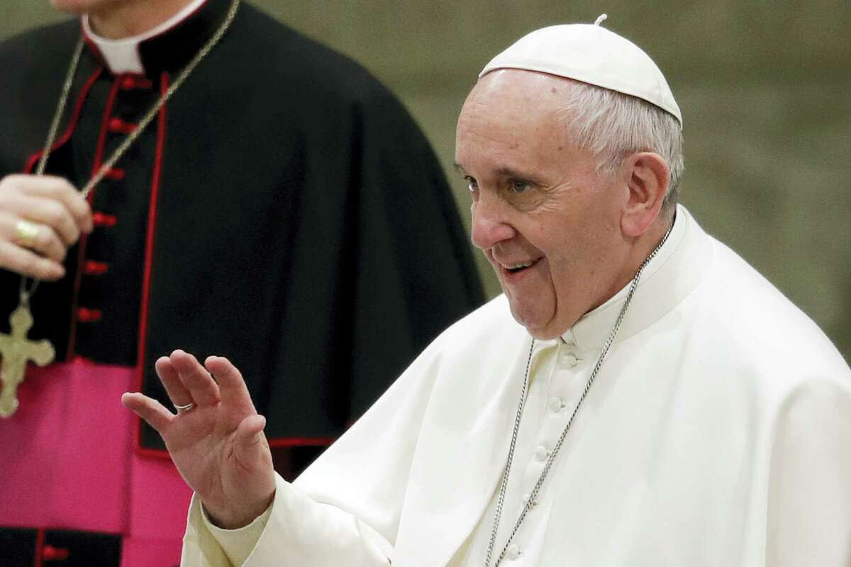 Pope Francis greets faithful during his weekly general audience, in the Pope Paul VI hall, at the Vatican Jan. 18.