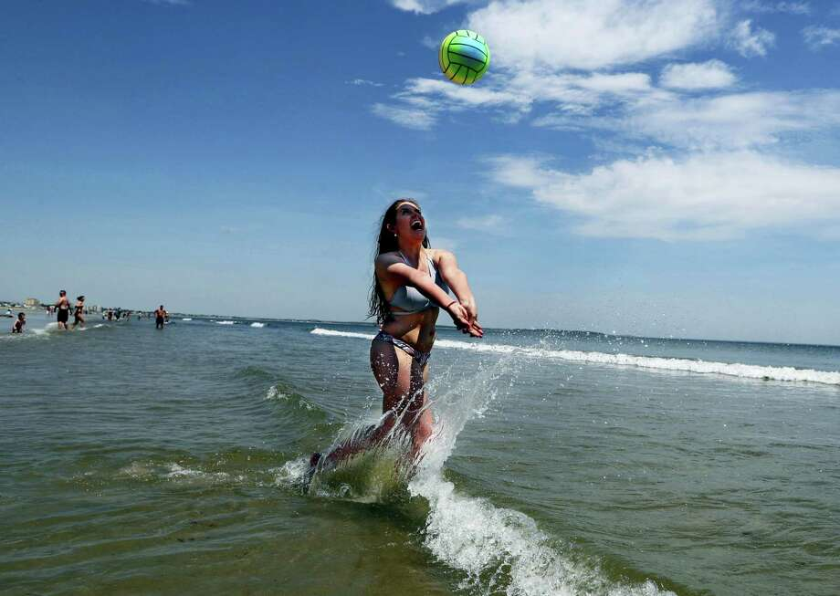 Nessa King of Wyndham, Maine, returns a shot while playing volleyball in record breaking heat at Old Orchard Beach, Maine, Thursday, May 18, 2017. King was one of hundreds of Maine high school seniors who skipped school to enjoy a day at the beach with classmates. Photo: Robert F. Bukaty — AP Photo  / Copyright 2017 The Associated Press. All rights reserved.