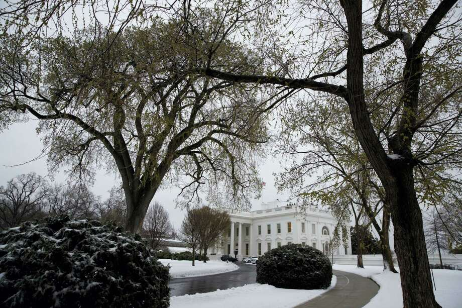 Snow covers the ground outside of the White House in Washington, Tuesday, March 14, 2017. A late-season storm is dumping a messy mix of snow, sleet and rain on the mid-Atlantic, complicating travel, knocking out power and closing schools and government offices around the region. Photo: AP Photo —Evan Vucci / Copyright 2017 The Associated Press. All rights reserved.