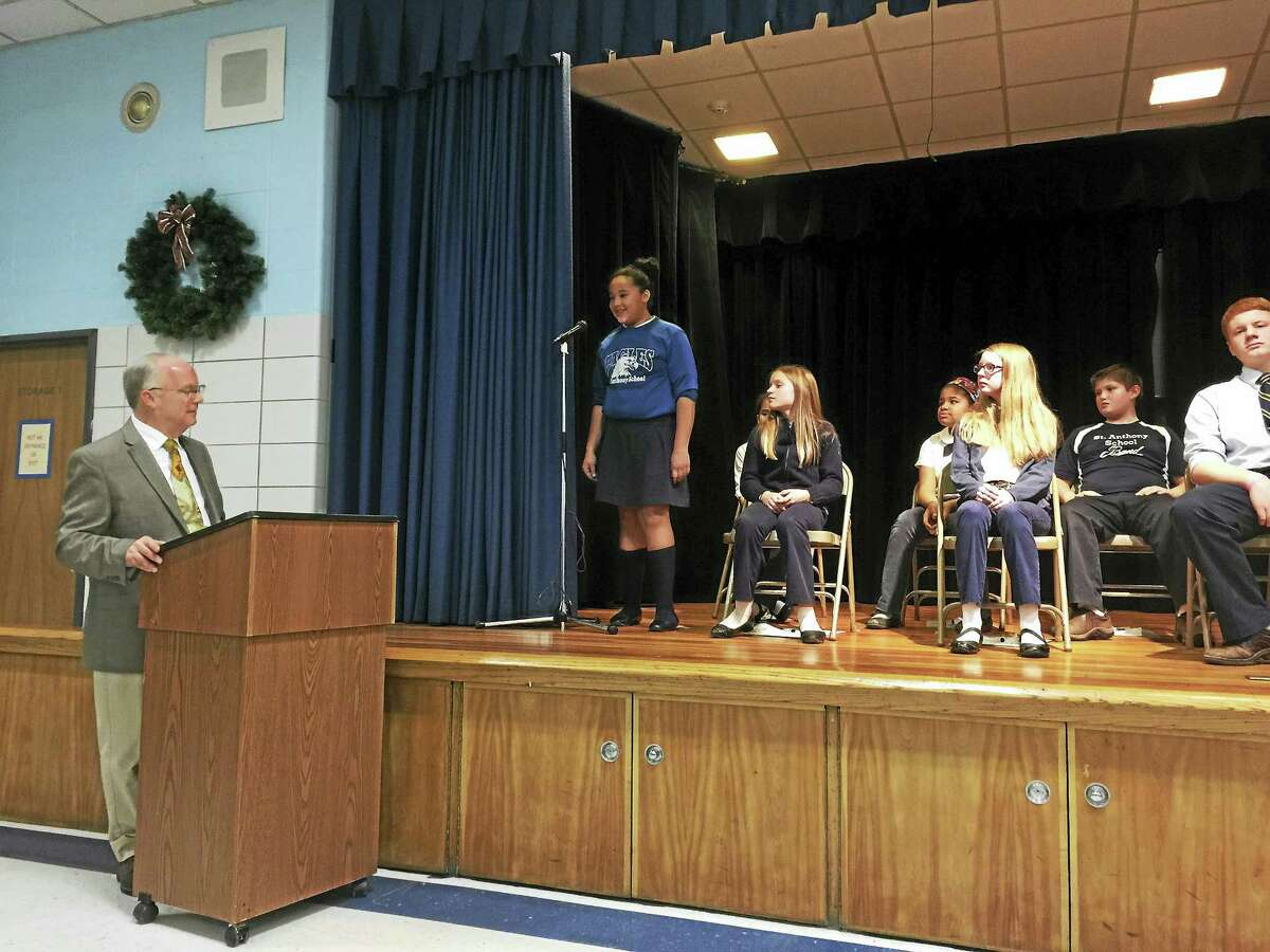 Ben Lambert — The Register Citizen A group of 10 students St. Anthony School students participate in the annual geography bee, held on Monday in Winsted. Above, a student answers a question during the bee.