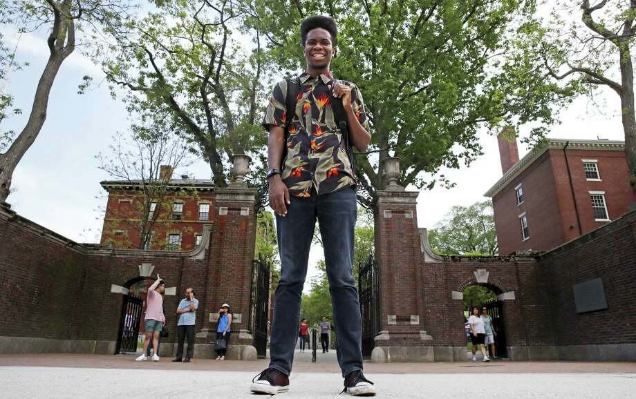 "Obasi Shaw poses outside the gates of Harvard Yard in Cambridge, Mass., Thursday, May 18, 2017. Shaw, an English major who graduates from Harvard next week, is the university's first student to submit his final thesis in the form of a rap album. The record, called ""Liminal Minds,"" has earned the equivalent of an A- grade, good enough to ensure that Shaw will graduate with honors at the university's commencement next week. Photo: Charles Krupa — AP Photo  / Copyright 2017 The Associated Press. All rights reserved."
