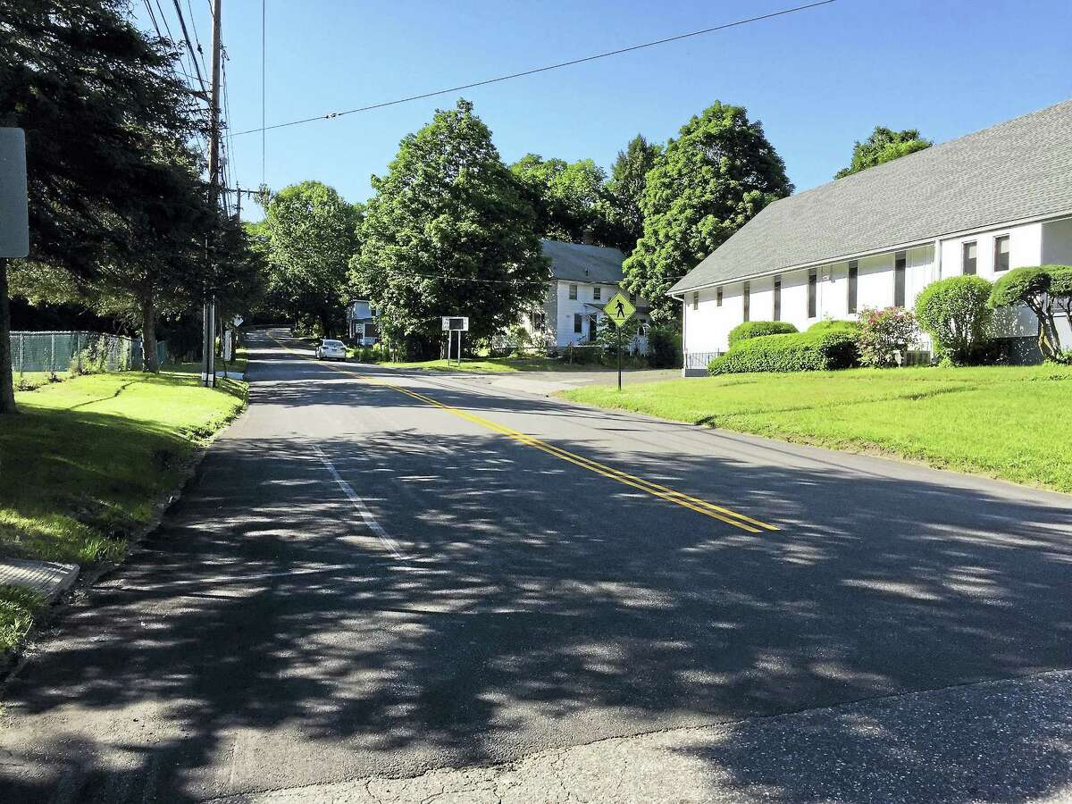 City officials pledged to pay the city's share of a paving project for Newfield Road, shown in a photo taken last summer.