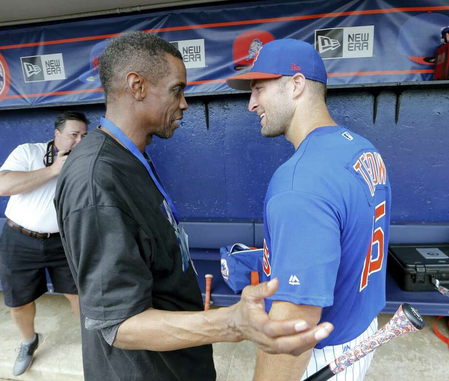 Tim Tebow, right, talks with former Mets pitcher Dwight Gooden before a spring training game Monday in Port St. Lucie, Fla. Photo: John Bazemore — The Associated Press  / Copyright 2017 The Associated Press. All rights reserved.