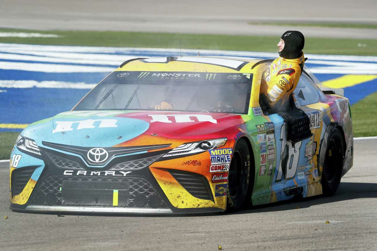 Kyle Busch climbs out of his smoking car at the end of the Sunday's race in Las Vegas.