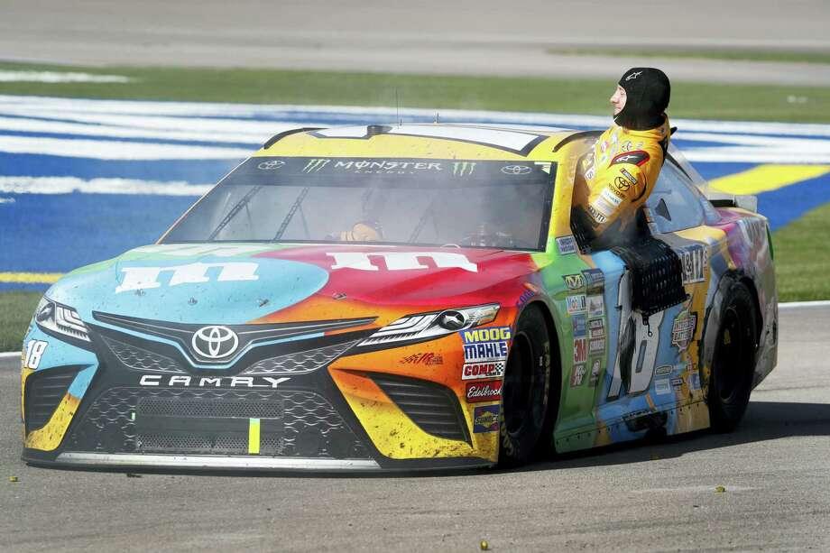 Kyle Busch climbs out of his smoking car at the end of the Sunday's race in Las Vegas. Photo: Steve Marcus — Las Vegas Sun Via AP  / LAS VEGAS SUN
