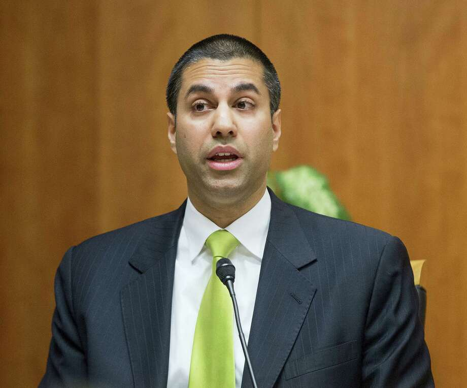 """In this Feb. 26, 2015 photo, Federal Communication Commission Commissioner Ajit Pai speaks during an open hearing and vote on """"Net Neutrality"""" in Washington. The FCC has voted to kick off the repeal of 'net neutrality' rules designed to keep broadband providers like AT&T, Verizon and Comcast from interfering with the internet. Photo: AP Photo — Pablo Martinez Monsivais, File  / Copyright 2017 The Associated Press. All rights reserved."""