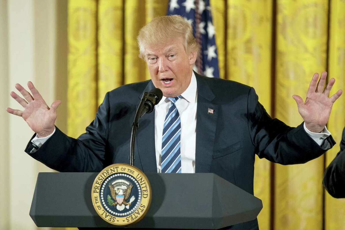 In this Sunday, Jan. 22, 2017 photo, President Donald Trump speaks during a White House senior staff swearing-in ceremony in the East Room of the White House, in Washington. Trump's economic plans are nothing if not ambitious. Yet even to come anywhere near his goals, economists say Trump would have to surmount at least a half-dozen major hurdles that have long defied solutions.