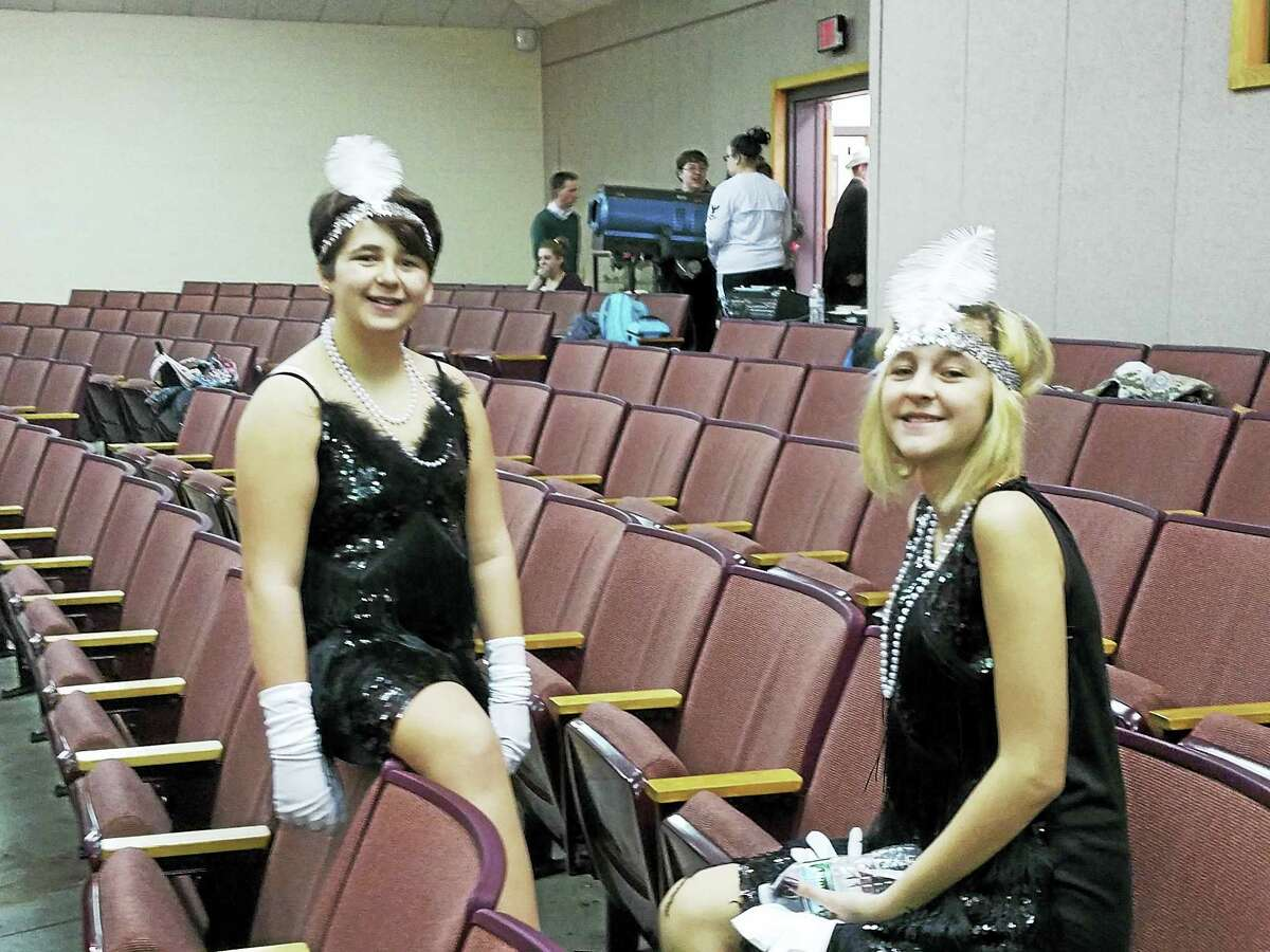 """Two """"flapper girls"""" cast members take a break during rehearsals for Anything Goes at Torrington Middle School."""