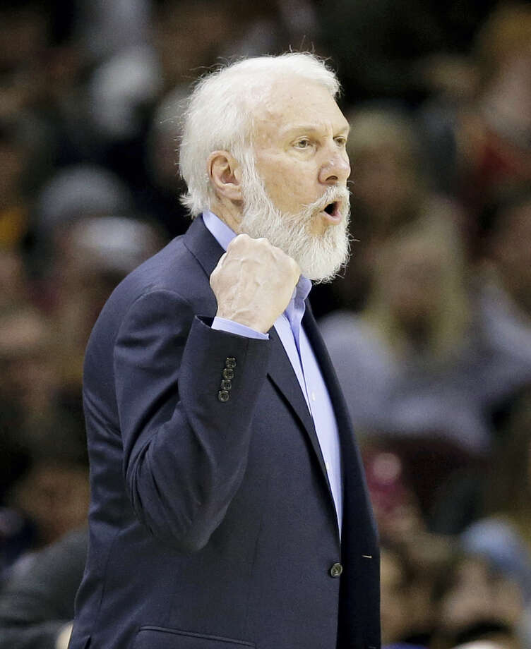 San Antonio Spurs head coach Gregg Popovich yells to players in the first half of an NBA basketball game against the Cleveland Cavaliers on Jan. 21, 2017 in Cleveland. San Antonio's long-time coach, who has been highly critical of Donald Trump in the past, went on a lengthy rant about the newly sworn-in president on Saturday night, calling him a bully and saying he hopes he can change while in office. Photo: AP Photo/Tony Dejak  / AP 2017