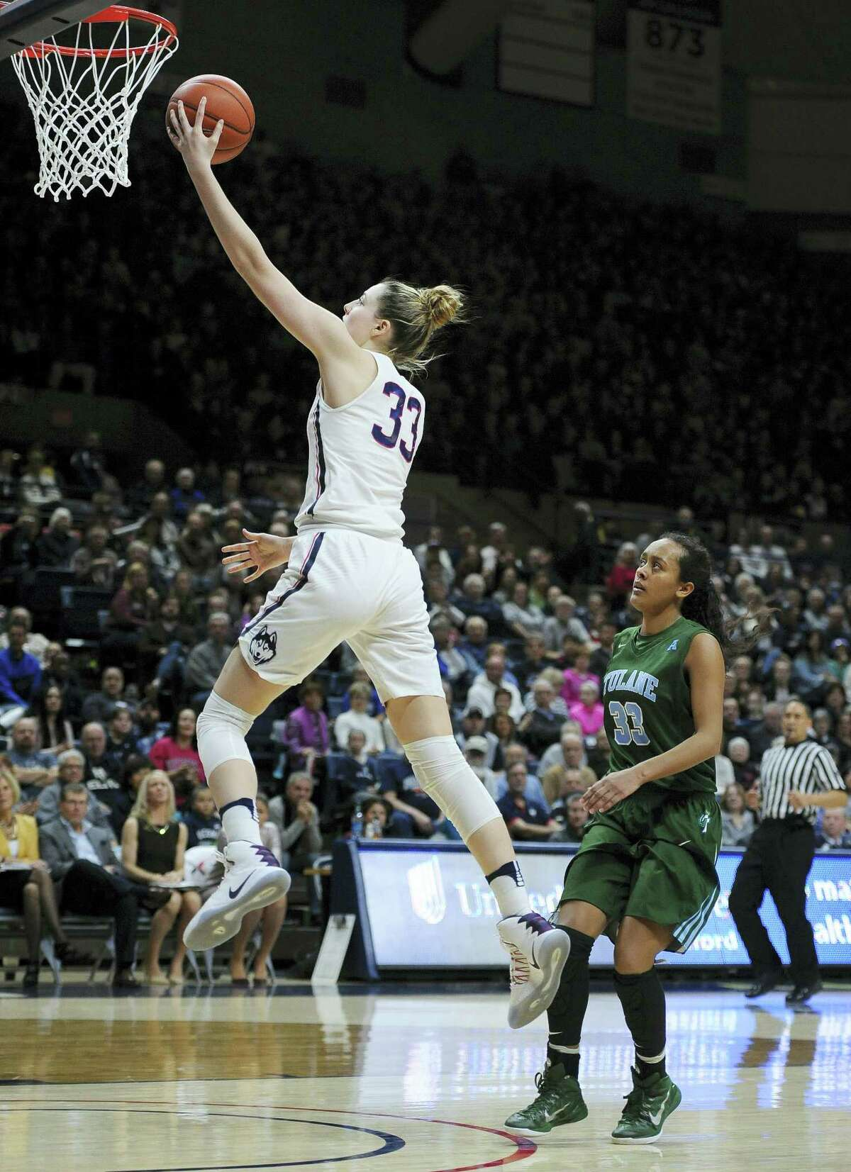 UConn's Katie Lou Samuelson, left, goes up for a layup after a breakaway steal against Tulane on Sunday.