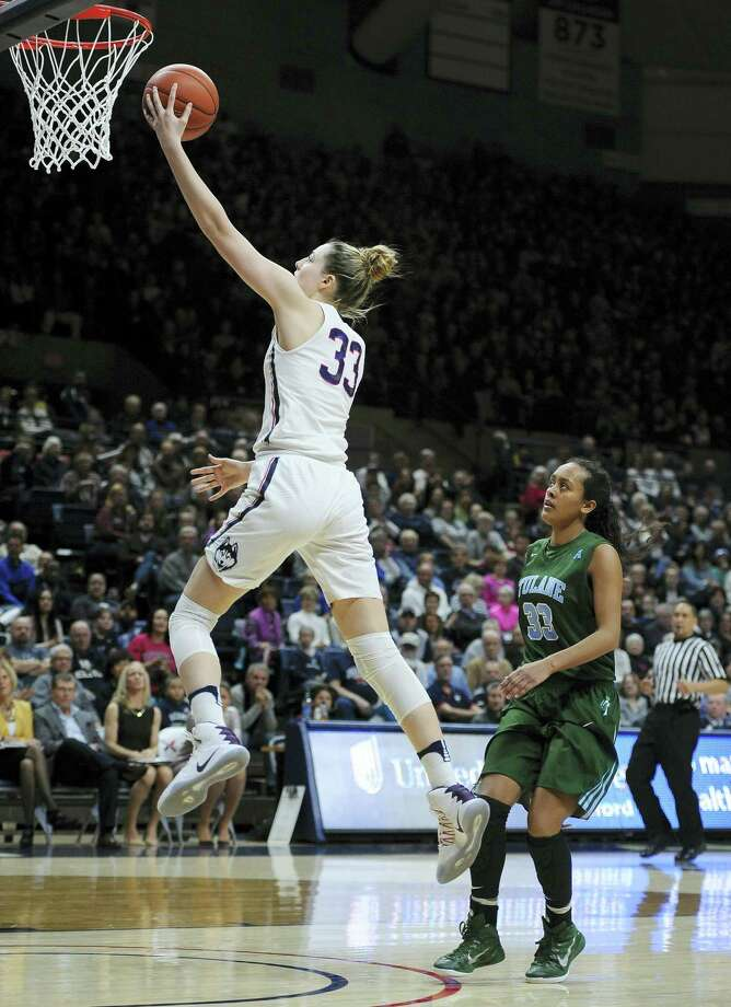 UConn's Katie Lou Samuelson, left, goes up for a layup after a breakaway steal against Tulane on Sunday. Photo: Jessica Hill — The Associated Press  / AP2017