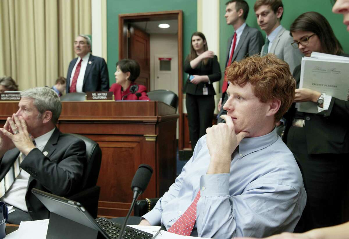 """In this photo taken March 9, 2017, House Energy and Commerce Committee member Rep. Joseph P. Kennedy III, D-Mass., joined at left by Rep. Kurt Schrader, D-Ore., listens on Capitol Hill in Washington as debate continues after working through the night with members of the committee on the GOP's """"Obamacare"""" replacement bill. A familiar name from Massachusetts is carrying his family legacy into a new era, battling Republicans who want to undo Barack Obama's health care law."""