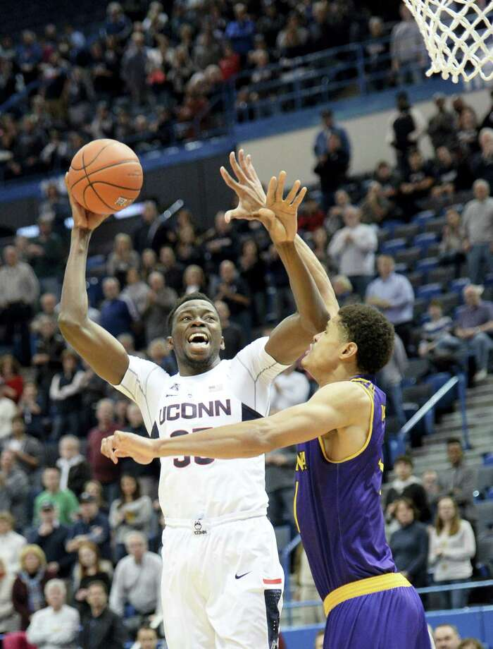 UConn's Amida Brimah, left, shoots over East Carolina's Andre Washington on Sunday. Photo: Stephen Dunn — The Associated Press  / FR171426 AP