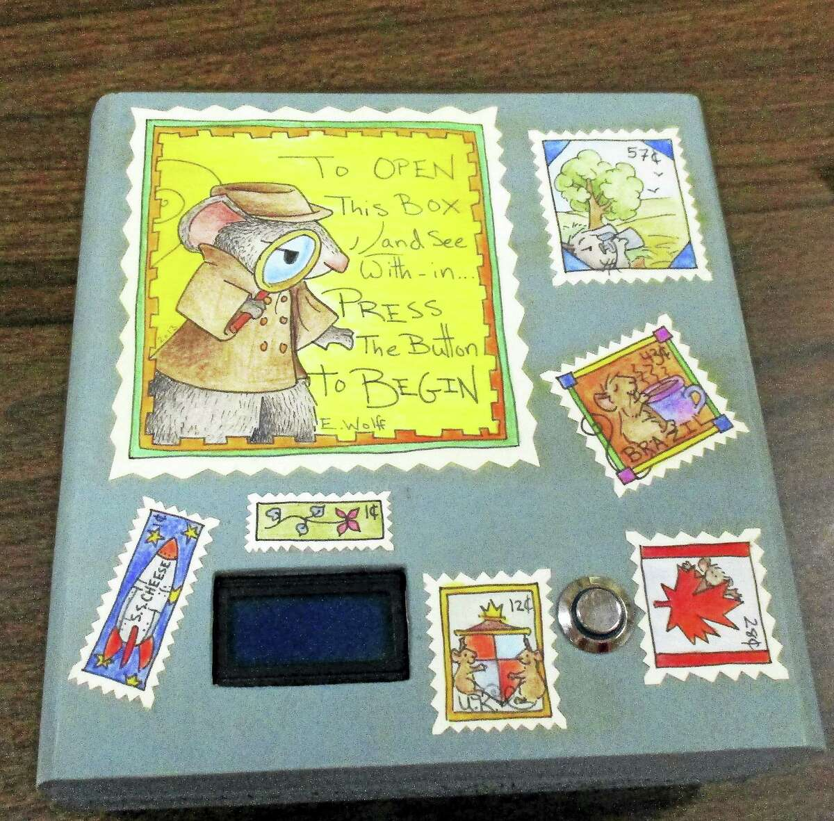 The Mystery Puzzle Box, designed by Denis Williamson and decorated by artist Elizabeth Wolff, is one of the prizes available for bidding at the Morris Public Library's annual fundraiser, Art Around the Box.