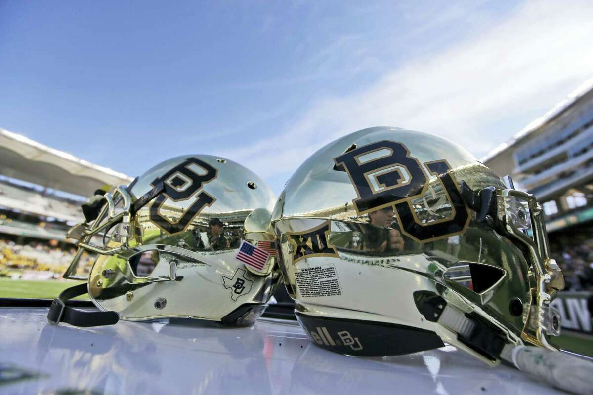 In this Dec. 5, 2015, file photo, Baylor helmets on shown the field after an NCAA college football game in Waco, Texas. A new federal lawsuit against Baylor University alleges football players routinely recorded gang rapes and staged dogfights in a program that fostered sexual violence. A former Baylor volleyball player identified only as Jane Doe filed the lawsuit Wednesday, May 17, 2017.