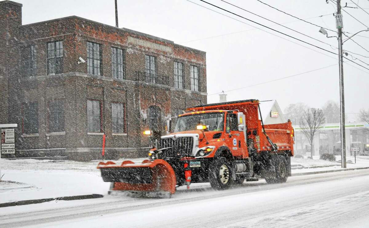 A Torrington snow plow heads out to clear the roads during a recent storm.