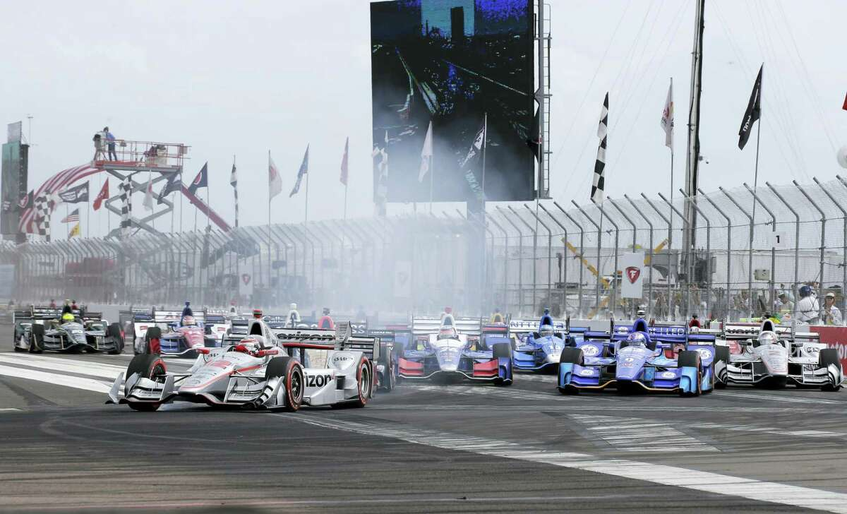 Will Power (12), of Australia, leads the field into Turn 1 after taking green flag for the IndyCar Firestone Grand Prix of St. Petersburg auto race on March 12, 2017 in St. Petersburg, Fla.