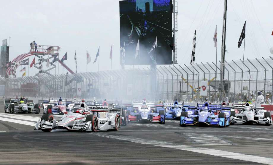 Will Power (12), of Australia, leads the field into Turn 1 after taking green flag for the IndyCar Firestone Grand Prix of St. Petersburg auto race on March 12, 2017 in St. Petersburg, Fla. Photo: AP Photo — Terry Renna  / FR60642 AP