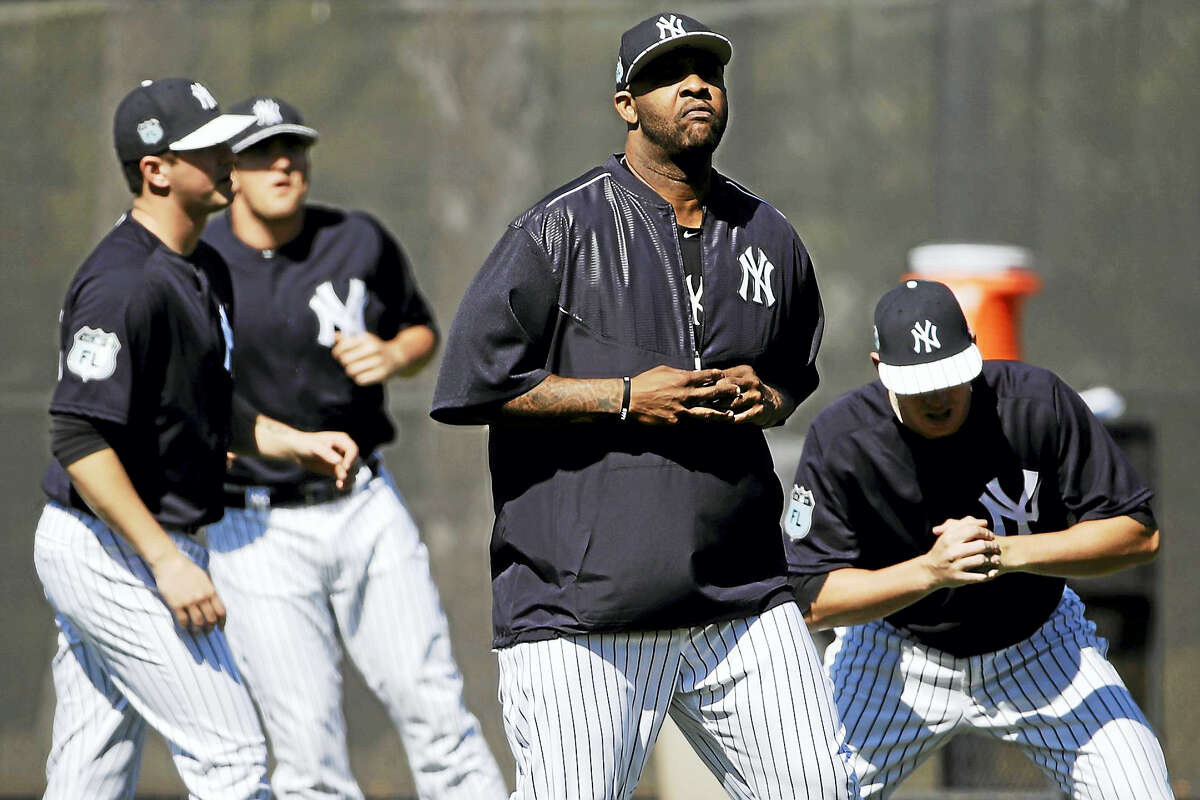 The Yankees CC Sabathia, center, and his teammates run a drill during a spring training workout.