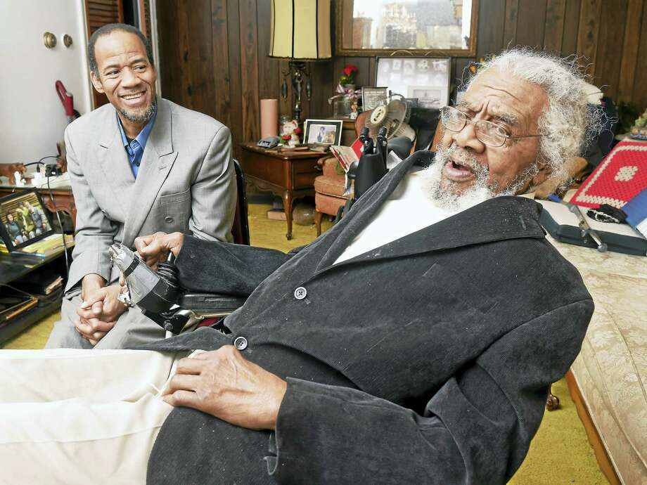 Author Glenn Ellis, left, is photographed with Jefferson Evans, the subject of his book, Why Do People Treat Me The Way They Do?, the Autobiography of Jefferson Evans, at Evans' home in Cheshire. Photo: Arnold Gold — New Haven Register