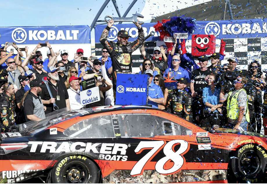 Martin Truex Jr. celebrates after winning Sunday in Las Vegas. Photo: David Becker — The Associated Press  / FR170737 AP