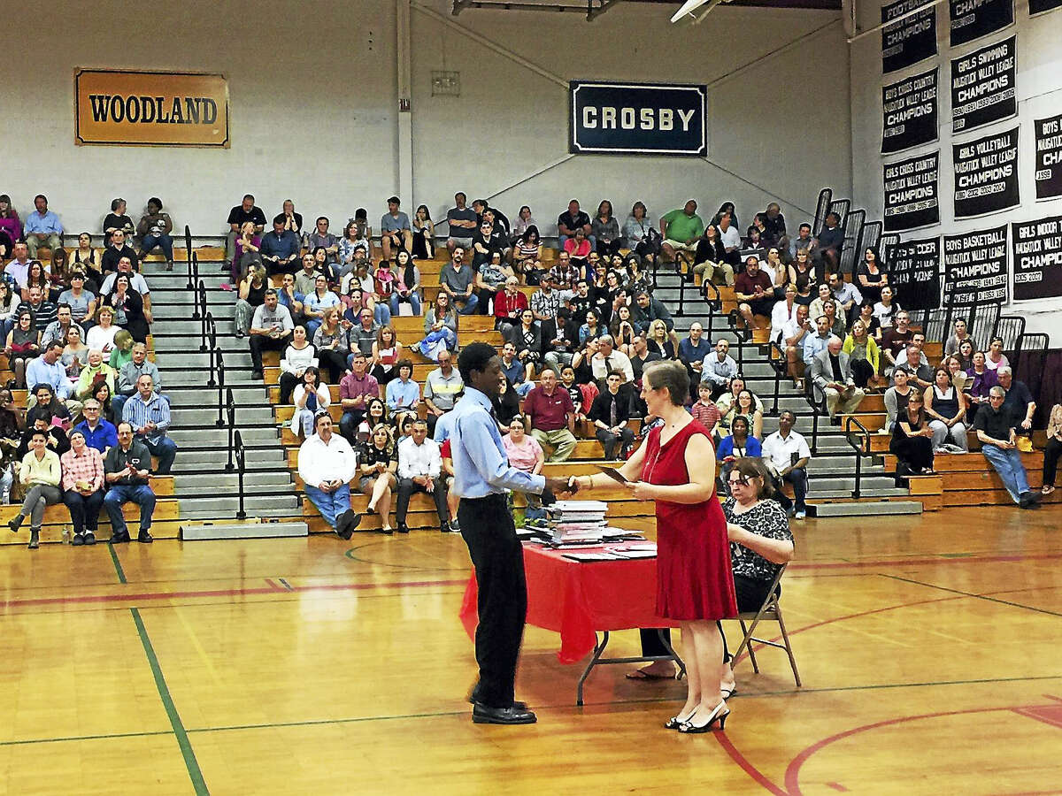 Torrington High School students were recognized for their accomplishments Tuesday during Academic Awards Night, As students' names were called, presenters often included a hug as they congratulated their students, many of them seniors who will graduate in June.