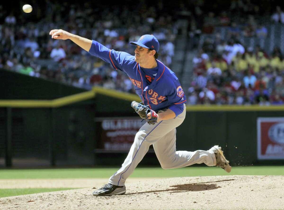New York Mets starting pitcher Matt Harvey throws against the Arizona Diamondbacks during the third inning.
